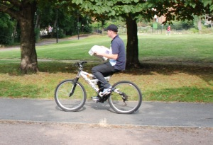 Riding-a-bike-while-reading-a-paper